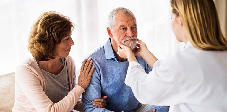 Doctor examining man's lymph nodes