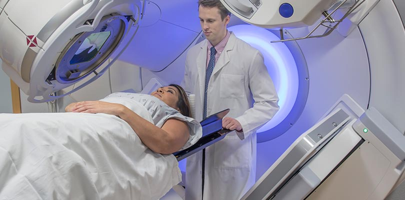 Woman receiving radiation therapy treatments